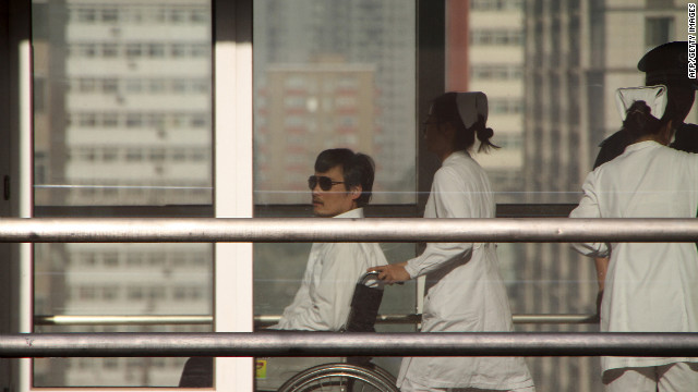 Chinese activist activist Chen Guangcheng (L) is seen in a wheelchair pushed by a nurse at the Chaoyang hospital in Beijing on May 2, 2012. A US official said there would be no repeat of the incident involving the activist Chen