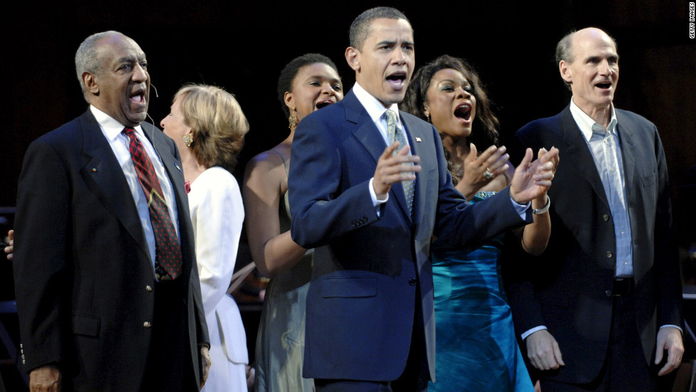 President Obama leads a birthday salute to Sen. Ted Kennedy in Washington on March 8, 2009. He was joined onstage by performers such as comedian Bill Cosby, left, and singer-songwriter James Taylor, right. Kennedy's birthday was February 22.