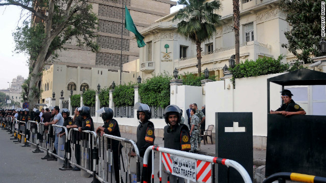 Egyptian security forces stand guard outside the Saudi embassy in Cairo on April 28, 2012.