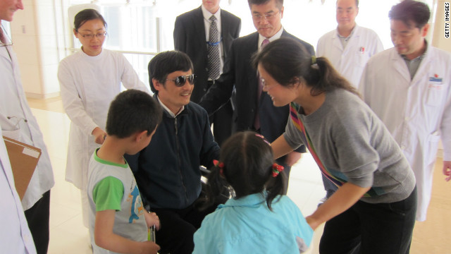 Chinese dissident Chen Guangcheng (C) and Chen's wife Yuan Weijing (R) and children meet him along with U.S. Ambassador to China Gary Locke May 2, 2012 in Beijing, China.