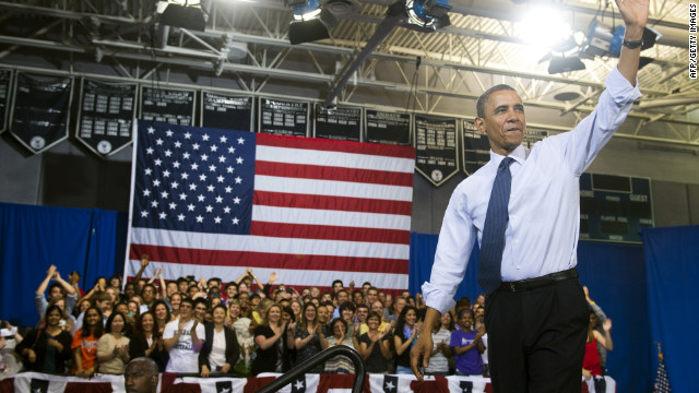 President Obama waves Friday after speaking to students at Washington-Lee High School in Arlington, Virginia.