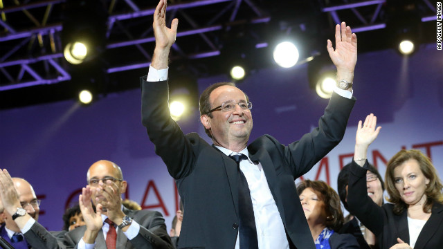 France's newly elected president Francois Hollande celebrates at the Place de la Bastille in Paris on May 7.