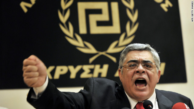 Nikolaos Michaloliakos, of Greece's far-right Golden Dawn party, celebrates wins in weekend parliamentary elections.