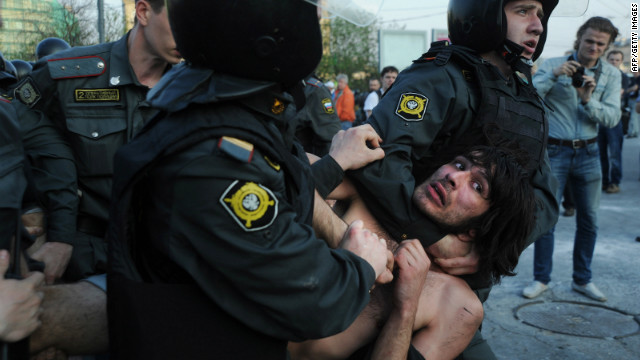 Russian Police officers detain opposition supporters during a rally in Moscow on May 6, 2012.