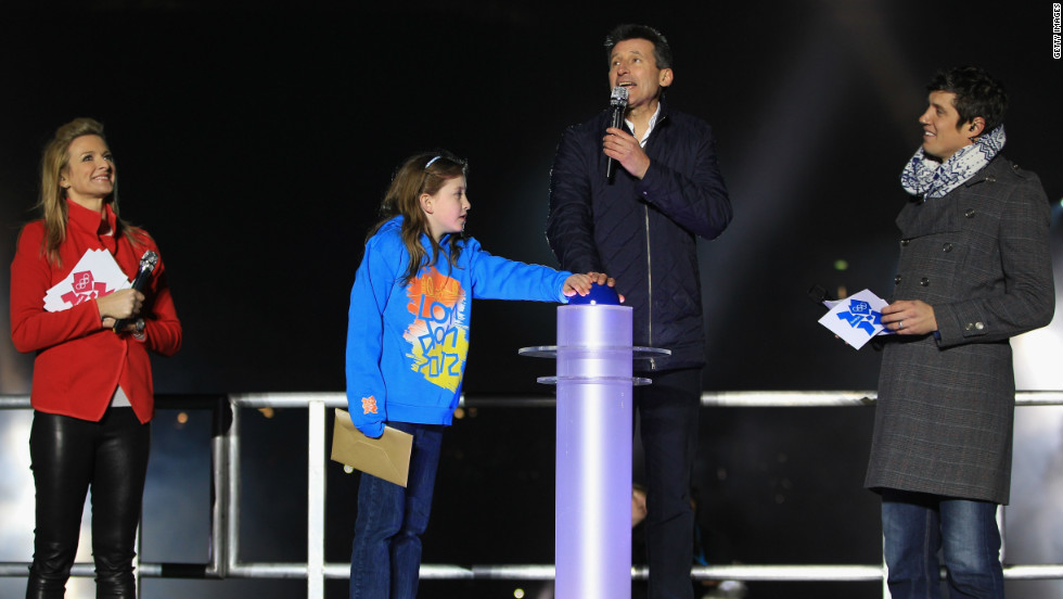 Nine-year-old schoolgirl Niamh Clarke-Willis makes history as she presses the button to officially open the Olympic stadium along with London 2012 chairman Sebastian Coe. They were joined on stage by TV presenters Gabby Logan and Vernon Kay.