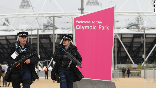 Armed police officers patrol Olympic Park during a test event at London's Olympic Stadium in London on May 5.