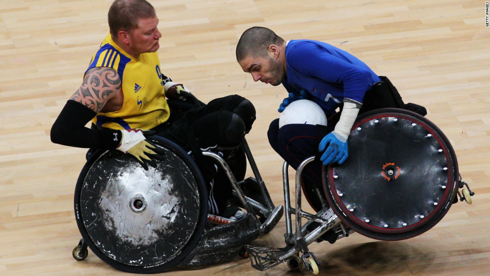 Sweden's Per-Johan Uhlmann (left) battles with Britain's Aaron Phipps during a London 2012 test event on April 18.
