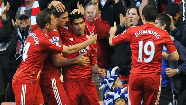Liverpool's players celebrate after Luis Suarez (C) created their opening goal against Chelsea at Anfield