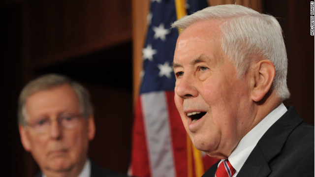 US Sen. Richard Lugar, R-IN, speaks to reporters as Sen. Minority Leader Mitch McConnell,R-KY, looks on November 30, 2011 during a presser on Capitol Hill in Washington, DC. The Senators held a press conference to discuss the Keystone XL pipeline. AFP PHOTO /Karen BLEIER (Photo credit should read KAREN BLEIER/AFP/Getty Images)