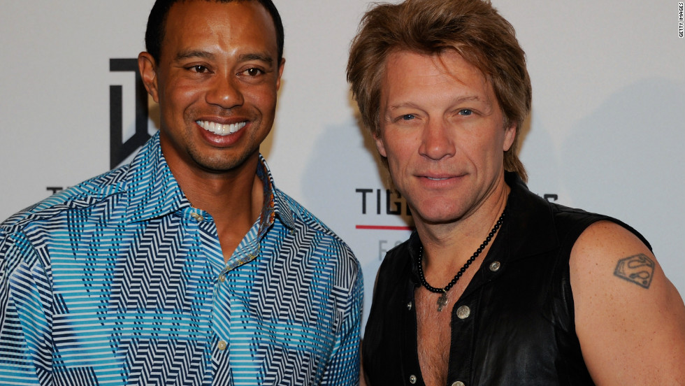 Woods with rock star Jon Bon Jovi, who performed at Tiger Jam 2012 on  April 28. The event raised almost $1 million for Woods' charity foundation.