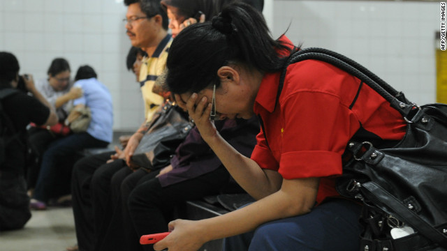 Relatives of passengers on the Russian Sukhoi Superjet 100 wait for news in Jakarta on May 9.