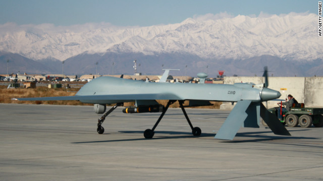 A U.S. Predator unmanned drone armed with a missile sets off from its hangar at Bagram Air Base on November 27, 2009.