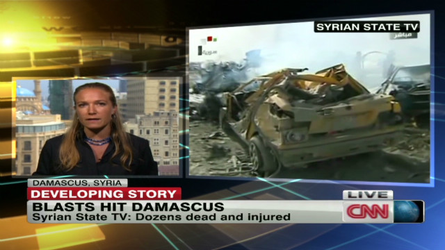 Twin explosions rock Syria's capital.