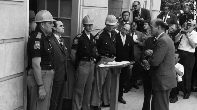 Deputy Attorney General Nicholas Katzenbach confronts Gov. George Wallace at the University of Alabama in 1963.