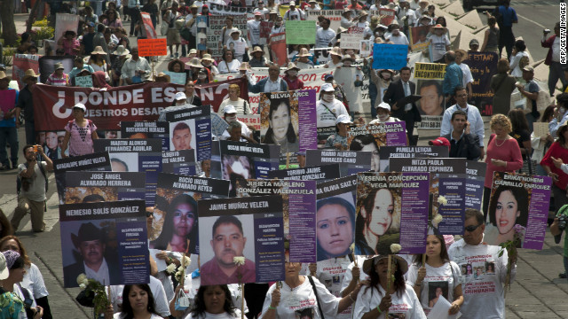 Hundreds from different states in Mexico march in Mexico City against forced disappearance Thursday.