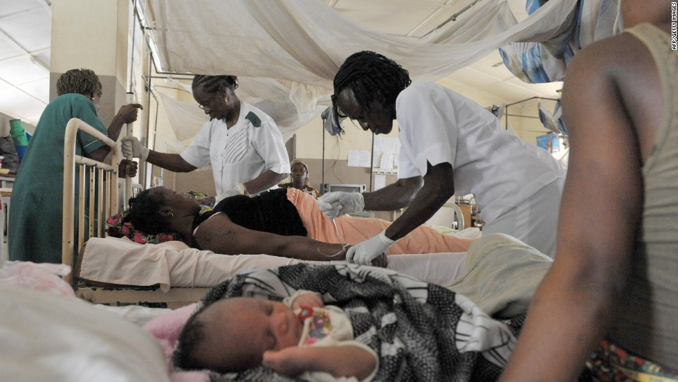 Nurses give aid to a pregnant woman before delivering a baby at the maternity ward of the central hospital in Freetown, Sierra Leone. The country has one of the highest maternal death rates in the world.