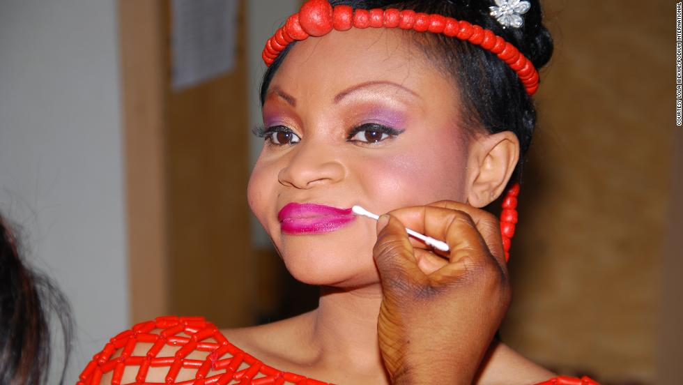 Lola Ibekwe, a Nigerian bride in the traditional outfit from the south west region, puts the finishing touches to her make up on the big day.