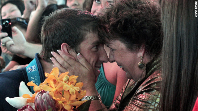 Olympic swimmer Michael Phelps is congratulated by his mother, Debbie, after a competition in Shanghai, China, last July