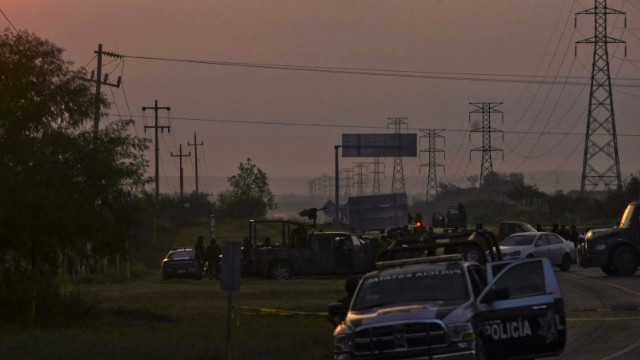 Mexican police block the road between the cities of Monterrey and Reynosa on Sunday. Dozens of mutilated bodies were found nearby.