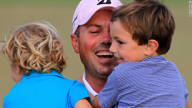 U.S. golfer Matt Kuchar celebrates with his sons Cameron (right) and Carson after winning the Players Championship in Florida.