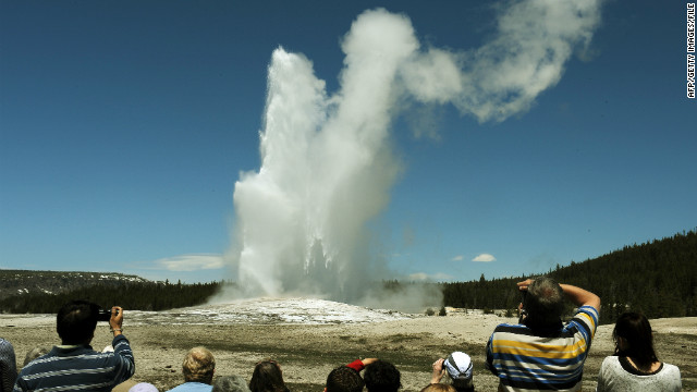 Crowds gather to watch the 'Old Faithful' geyser which erupts on average every 90 minutes in the Yellowstone National Park.