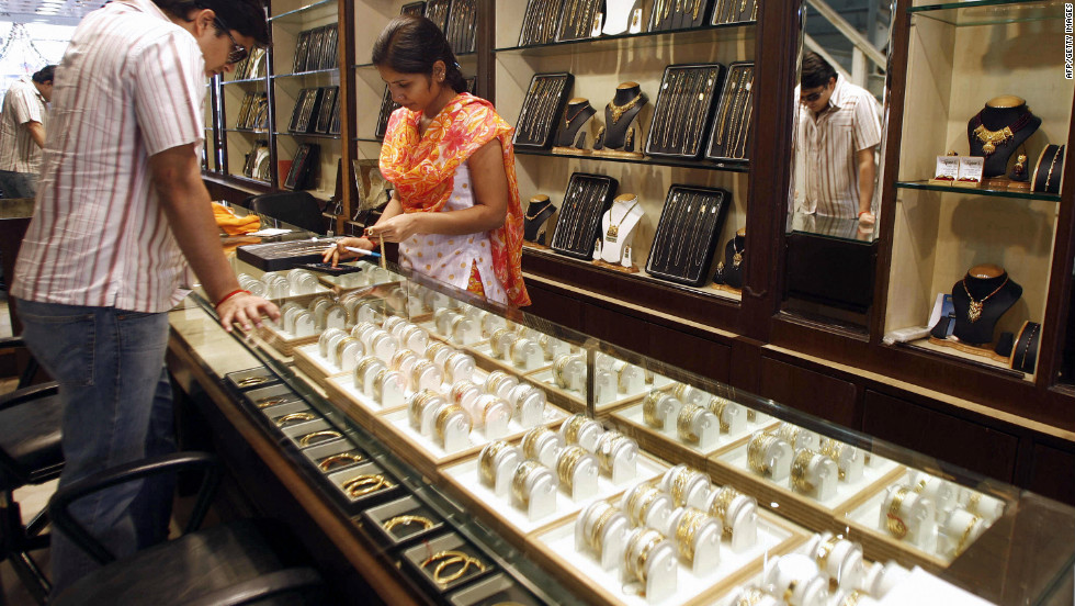 An Indian shop assistant shows a range of gold jewelry to a perusing customer. Gold signets, watches and bracelets are among the most popular adornments in India, and the capital city is a great place to bag a bargain. But be vigilant, as quality can vary greatly.