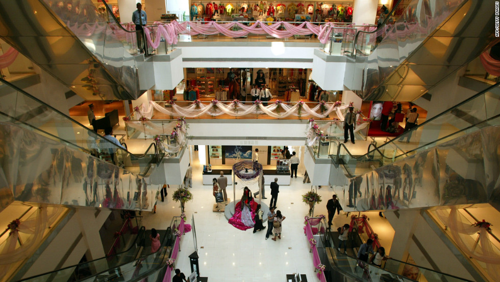 "Customers are seen browsing the boutique and commercial department stores inside the ""Shoppers Stop"" mall. Since it opened in 2007, the mall is said to be the largest in the country, spanning an area of 135,000 square feet and providing an overwhelming range of premium international and national brands."