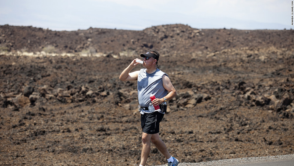 Carlos Solis, an elementary school teacher from Ontario, California, tries to stay hydrated as he runs through the lava fields.