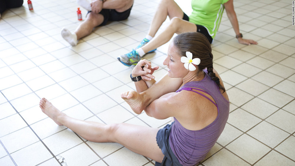 """Athletic director Burkey leads the """"Lucky 7"""" team in a stretch after a long run."""