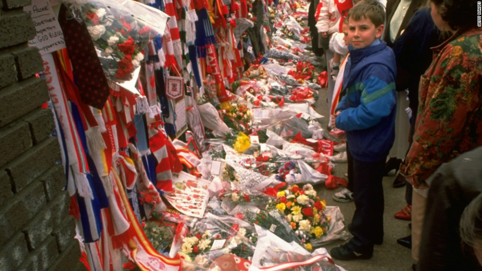 In the immediate aftermath, people from throughout Britain left tributes at Liverpool's Anfield stadium.