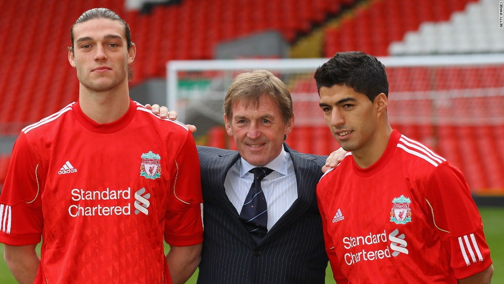 Dalglish spent heavily on his return to management, splashing out on players such as Luis Suarez (R), Stewart Downing and Jordan Henderson. His most eye-catching piece of business was the signing of striker Andy Carroll (L) from Newcastle United for a British record transfer fee.