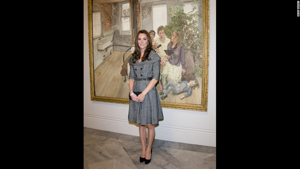 Wearing a gray coatdress, the Duchess of Cambridge posed for pictures at the National Portrait Gallery in London.