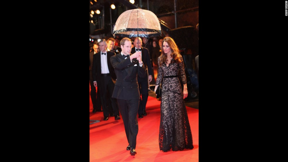 "Prince William kept his wife dry at the London premiere of ""War Horse"" on January 8, 2012. She wore a black lace <a href=""http://nymag.com/daily/fashion/2012/01/kate-middleton-war-horse-premiere-temperley.html"" target=""_blank"">Alice by Temperley</a> gown and carried a black clutch."