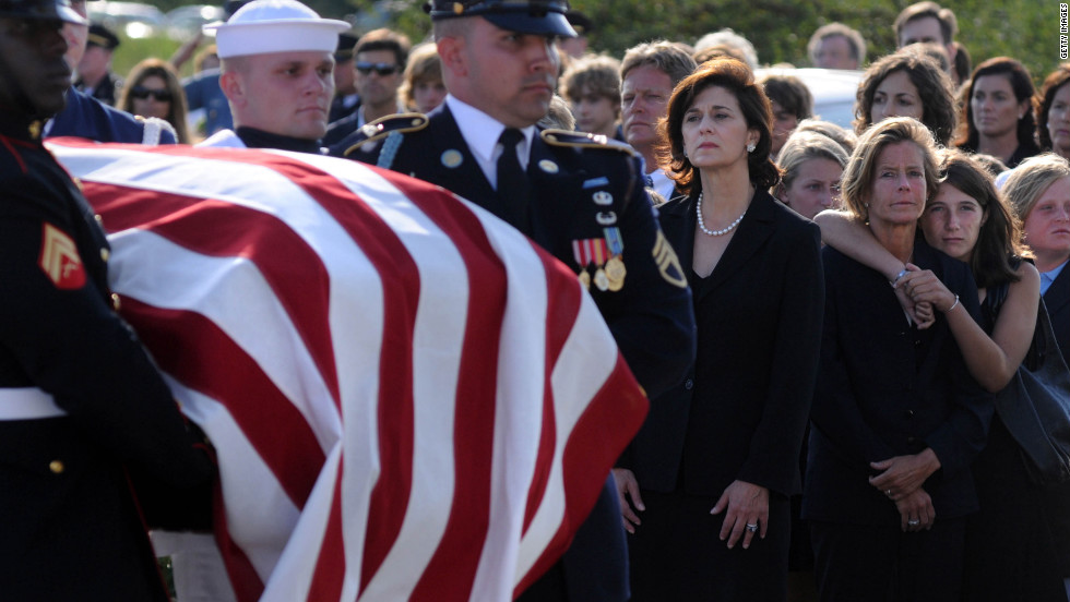 Members of the Kennedy family attend U.S. Sen. Ted Kennedy's funeral in August 2009. Two years later, his daughter, Kara Kennedy, died of a heart attack after her daily workout. She is shown being embraced by her daughter, Grace, at right.