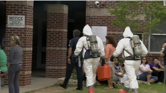 Investigators in protective gear check out a white-powder scare in Dallas last week.