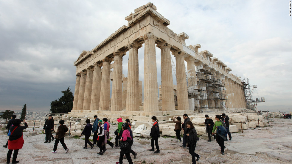 Despite protests elsewhere in Athens, tourists visit the Parthenon on the Acropolis in February 2012.