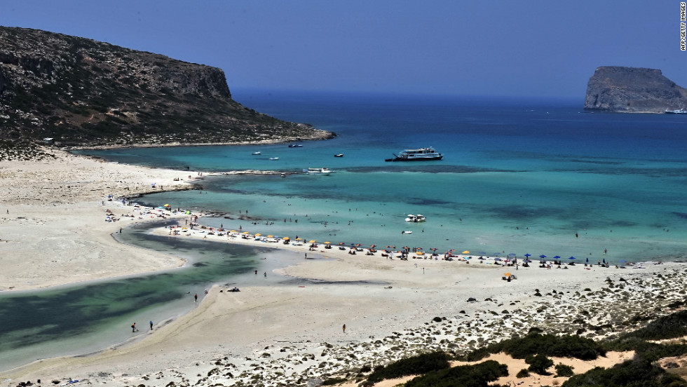 Tourists enjoy crystal-blue waters at Balos beach in northwestern Crete.