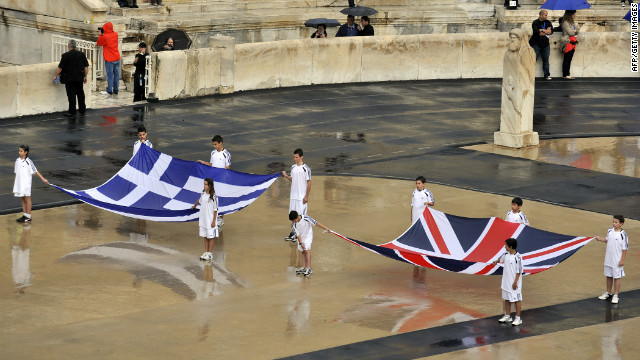 Children hold British and Greek flags during the handover ceremony for the 2012 London Olympics in Athens on Thursday.