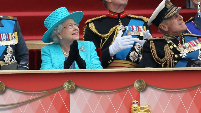 Queen Elizabeth II and Prince Philip watch the flypast in Windsor on Saturday.