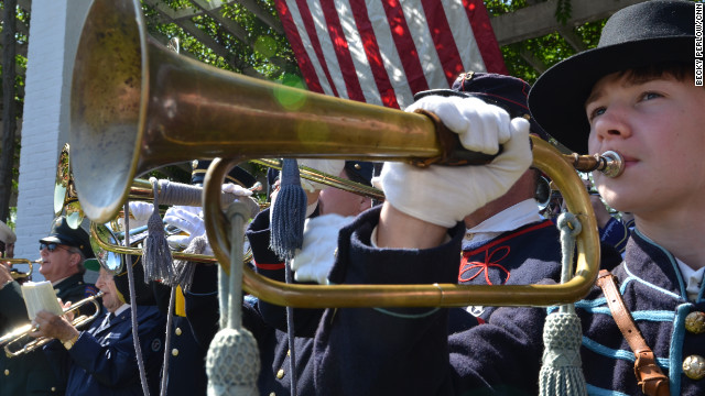"Buglers and trumpeters from around the United States gathered at Arlington National Cemetary in Washington D.C. on Saturday to commeorate the 150th anniversary of ""Taps, "" a musical piece traditionally played at military funerals. Currently, ""Taps"" is played at the cemetery about 30 times daily, most notably at the Tomb of the Unknown Soldier."