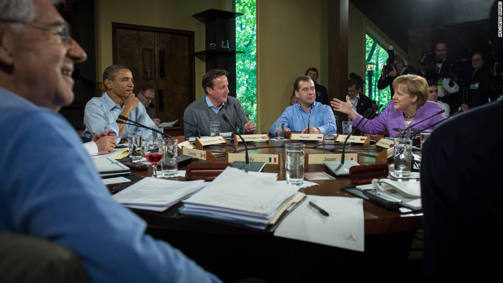 From left, Monti, Obama, Cameron, Medvedev and Merkel discuss issues during the first working session of the 2012 G8 summit at Camp David in Maryland.