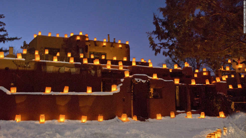 "Santa Fe has four distinctive seasons and the holidays are a nice time to visit. ""I love Christmas in Santa Fe,"" writes Whitney-Ward. ""Farolitos (lighted paper lanterns) march down every rooftop and along walls and pathways."""