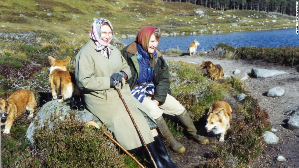 Rhodes sits resting with the Queen during a trek through deer-stalking area at Balmoral.