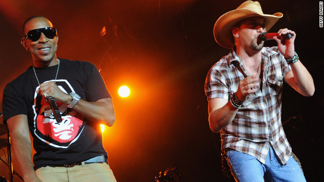 "Ludacris joins Jason Aldean during Aldean's ""My Kinda Party'"" tour stop in 2012 in  Atlanta, Georgia."
