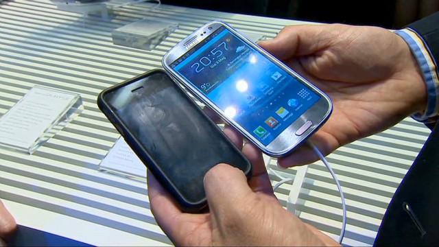 Electronic giants begin settlement talks