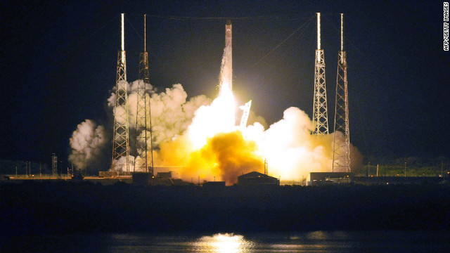 SpaceX's Falcon 9 rocket early May 22, 2012 as it heads for space carrying the company's Dragon spacecraft from pad 40 at Cape Canaveral, Florida.  The  Dragon capsule is scheduled to dock with the International Space Station in a few days.          AFP PHOTO  /   Bruce Weaver        (Photo credit should read BRUCE WEAVER/AFP/GettyImages)