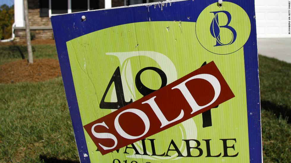 A Standard Pacific Homes sold sign stands in front of a home in Durham, North Carolina, U.S., on Sunday, Oct. 16, 2011. The National Association of Realtors is scheduled to release existing home sales data on Oct. 20. Photographer: Jim R. Bounds/Bloomberg via Getty Images