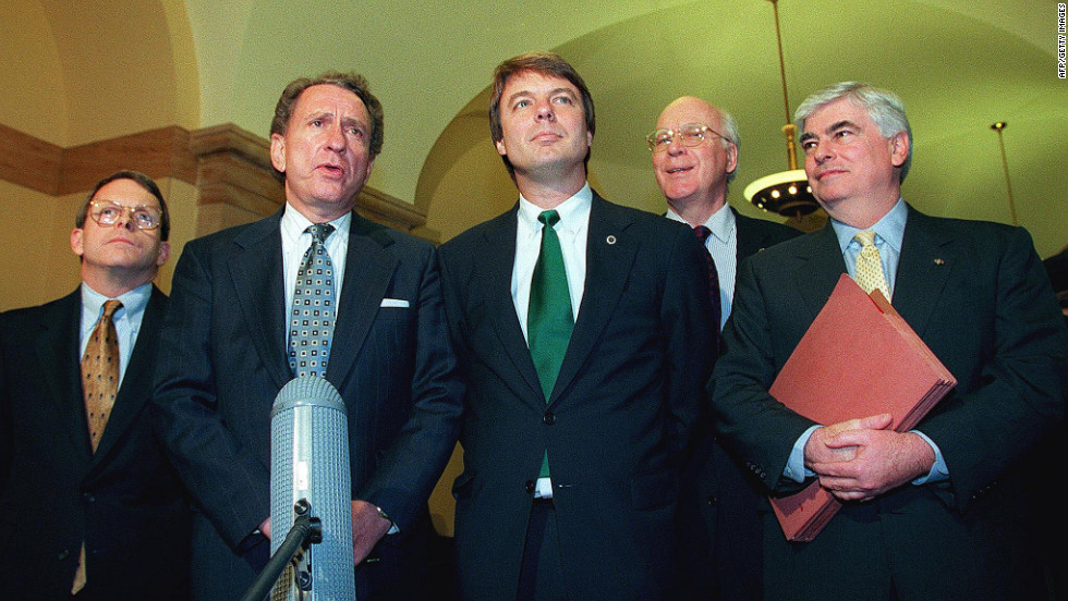 "U.S. Sen. John Edwards, center, and other senators discuss President Bill Clinton's impeachment trial on February 3, 1999. More than a year later, Vice President Al Gore reportedly put Edwards on his ""short list"" as a running mate on the 2000 Democratic presidential ticket (before picking Joe Lieberman)."
