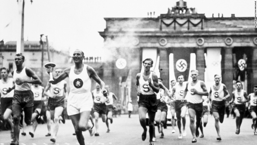 The torch relay was first used at the 1936 Olympics in Berlin, an idea instigated by Germany's then Nazi government. The flame was lit in Olympia, Greece, then carried to the Berlin stadium by runners through Bulgaria, Yugoslavia, Hungary, Austria and Czechoslovakia -- countries that would later fall under Hitler.