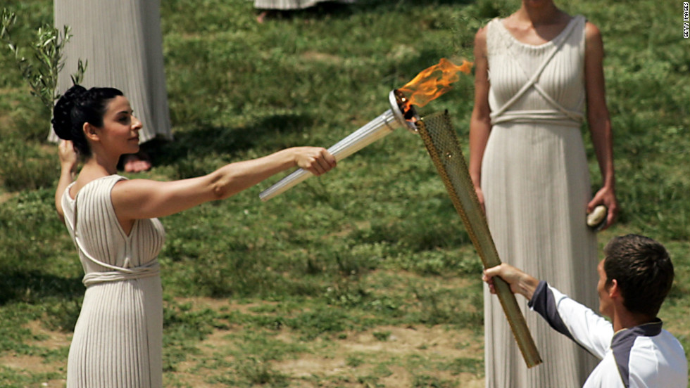 Amid the tumbledown columns and olive groves of the ancient stadium in Olympia, Greece, the 2012 flame is lit. Actor Ino Menegaki played the high priestess in the traditional ceremony on May 10.